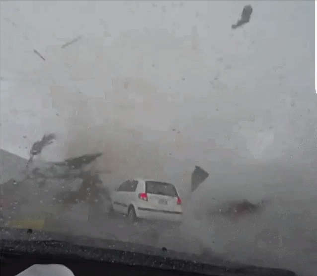 Tornado eating a car